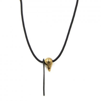 Gold metal eye brow necklace.